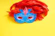 Leinwanddruck Bild - Carnival mask on yellow background