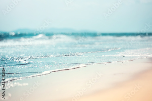 Close-up soft wave of the sea on the sandy beach - 318521120