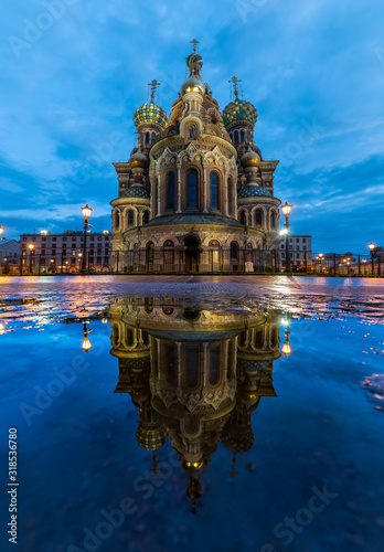 Low Angle View Of Illuminated Cathedral Against Cloudy Sky Reflecting On Puddle Wallpaper Mural