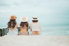 Three Woman Wearing Straw Hat ...