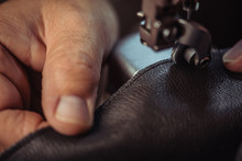 Cropped View Of Cobbler Sewing...