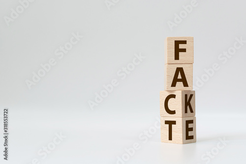 Fotografie, Obraz Fact or Fake concept, Wooden cube change the word, April fools day