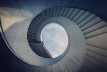 Low Angle View Of Spiral Stairs Against Sky