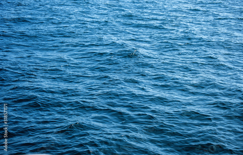obraz lub plakat Waves in ocean water surface