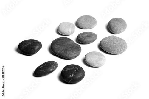 Fotografía Pebbles, black and gray color smooth sea stones isolated on white background