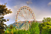 Ferris Wheel And Mountain In S...