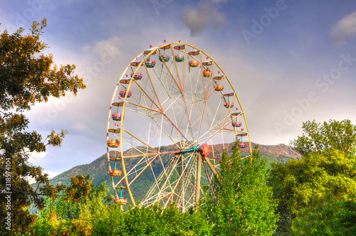 Fototapeta Ferris Wheel and Mountain in Switzerland. obraz