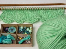 Knitting Pattern Design With Needles And Beads Green Yarn