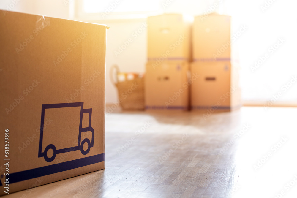 Fototapeta Move. Cardboard, boxes for moving into a new, clean and bright home