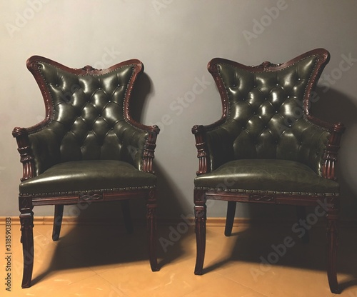Obraz Empty Chairs On Floor Against Wall At Home - fototapety do salonu