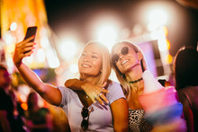 Two Girls Taking Selfie At The...