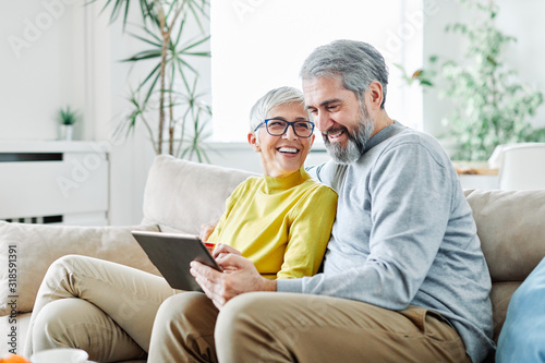 Obraz senior couple happy tablet computer love together - fototapety do salonu