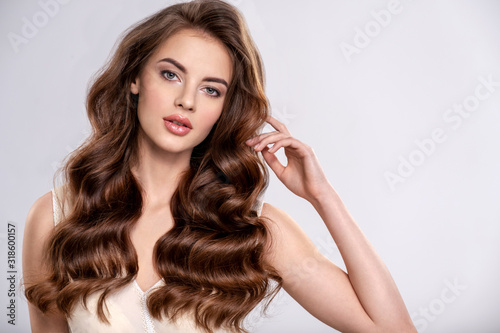 Obraz Portrait of a beautiful woman with a long brown hair. - fototapety do salonu