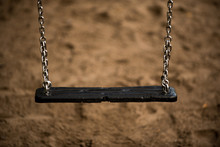 Close-Up Of Empty Swing At Playground