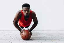 Portrait Of Basketball Player Exercising On Street