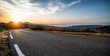 canvas print picture - Empty long mountain road to the horizon on a sunny summer day at bright sunset