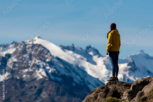 Alone hiker with yellow jacket admiring views over the Andes Canvas Print