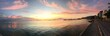 PANORAMIC VIEW OF SEA AGAINST CLOUDY SKY DURING SUNSET