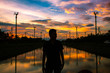Silhouette Man Standing At Lake Against Sky During Sunset