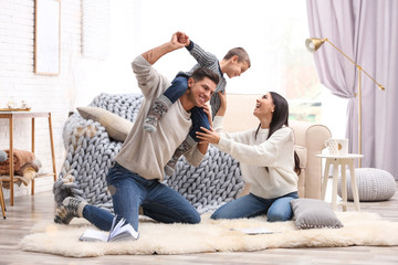 Happy family with little son having fun at home. Winter vacation