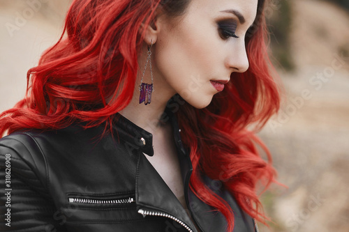 Fashionable close-up portrait of a model girl with red hair and trendy makeup in a leather jacket Wallpaper Mural