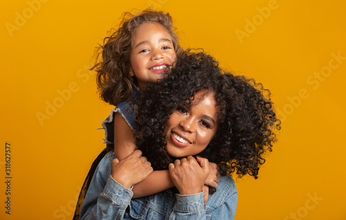 Obraz happy mother's day! Adorable sweet young afro-american mother with cute little daugh. - fototapety do salonu