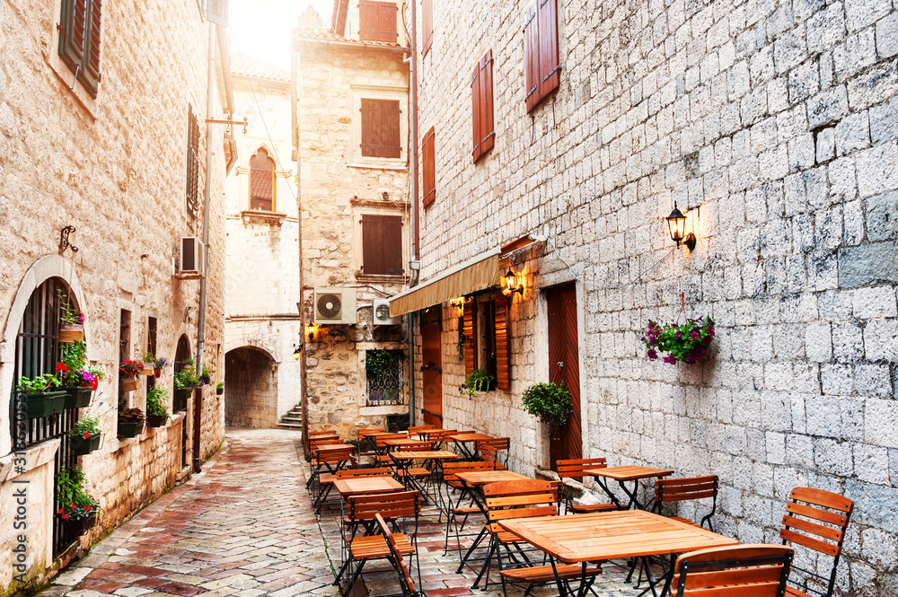 Cafe on the street in Old Town in Kotor, Montenegro. Famous travel destination.