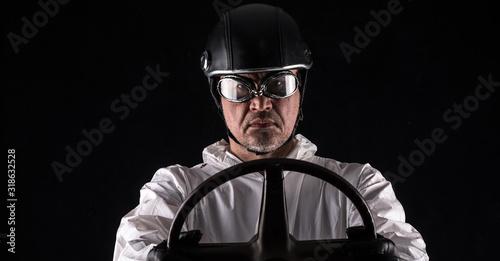 Fényképezés racer in a helmet in a white overalls