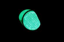 Close-Up Of Illuminated Green Traffic Light At Night