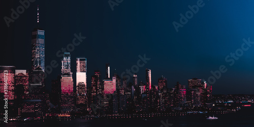 Fototapeta Amazing panorama view on New York City skyline and Downtown Manhattan from Jersey City during night. Banner image obraz
