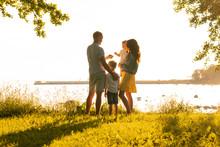 Happy Loving Family Walking Ou...
