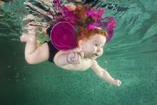 Redhead Little Girl  In Elf Co...