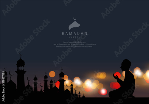 Silhouette of Religious Muslim Man offering Namaz in front of a Mosque in night, Muslim Community Festival celebration Wallpaper Mural