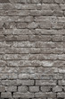 Old vintage shabby brick wall with peeling plaster. Grungy loft texture, background.