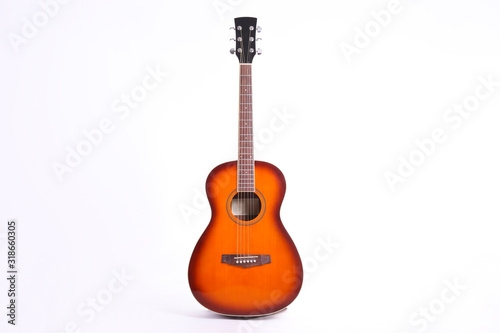 Fotografie, Obraz Folk style parlor acoustic guitar isolated on white background with a lot of copy space for text