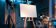 Easel With Blank Canvas Illumi...