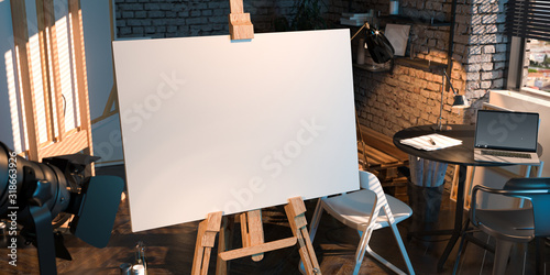 Easel With Blank Canvas Illuminated By Sun Light From Window With Modern Laptop on Background Wallpaper Mural