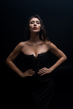 Sexy Woman In Corset With Hand...