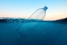 Empty Plastic Bottle Floats In...