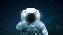 Spaceman In Open Space With Ha...