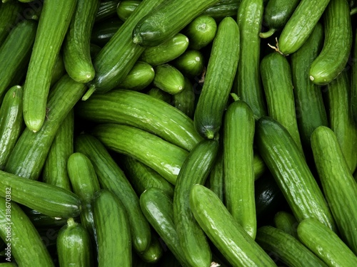 Full Frame Shot Of Cucumbers For Sale In Market - fototapety na wymiar