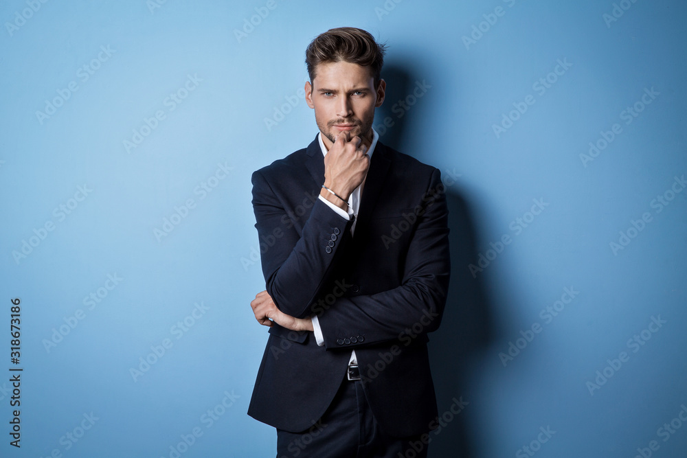 Fototapeta Handsome man wear black suit and thinking