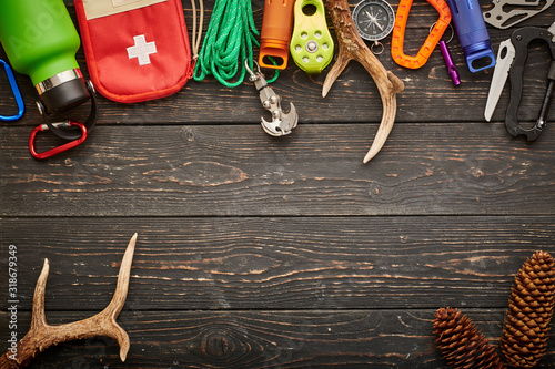 Travel items for hiking over wooden background Wallpaper Mural