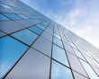 canvas print picture - glass facades of modern office buildings and reflection of blue sky