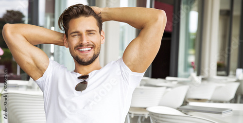 Portrait of handsome smiling man - fototapety na wymiar