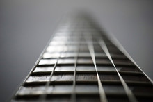 Close-Up Of Guitar Against Colored Background