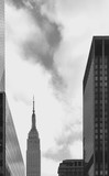 LOW ANGLE VIEW OF SKYSCRAPERS AGAINST CLOUDY SKY - 318694905