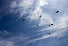 Low Angle View Of Helicopters Flying Against Sky