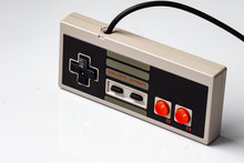 Retro Gaming Controller With Cable On White Background