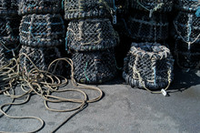 Close-Up Of Rope Tied To Stack...